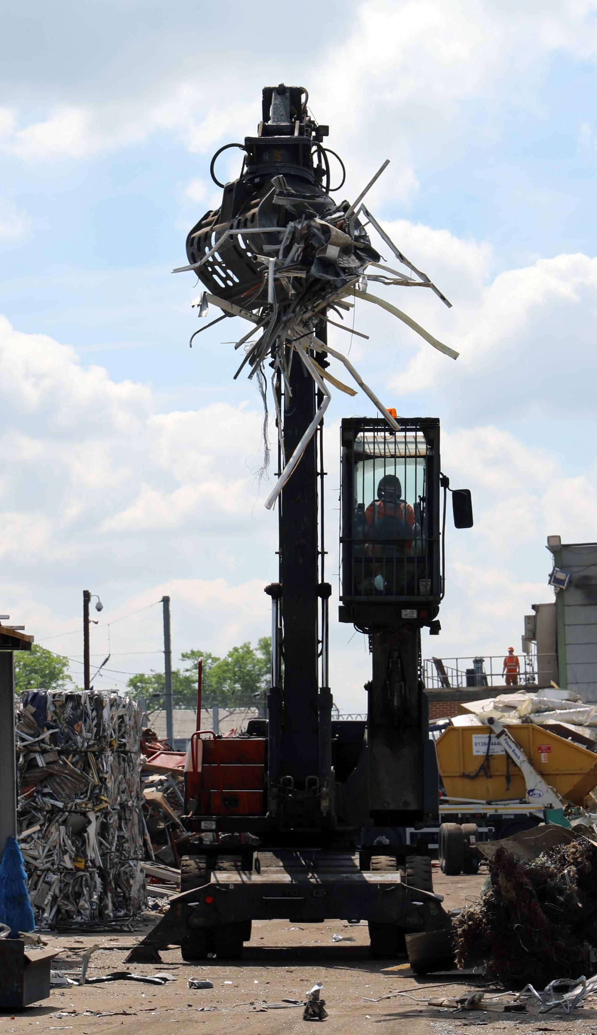 Sackers Technician Operating Heavy Machinery